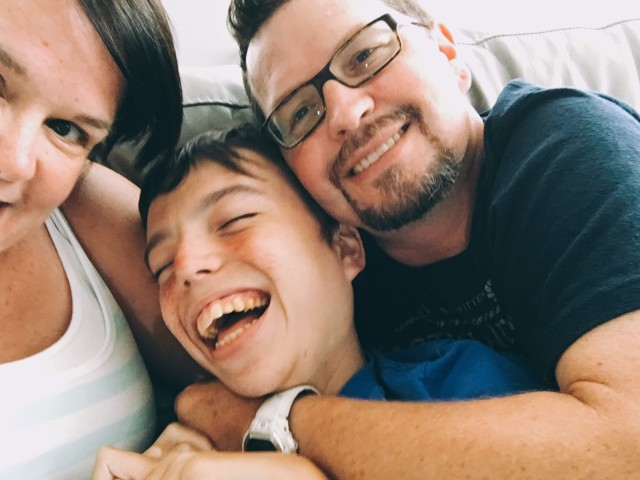 Family Laughing with Autism Son after hyperbaric oxygen therapy