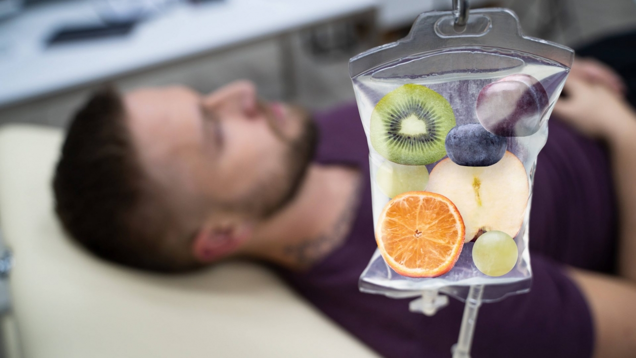 Man-laying-down-and-taking-IV-Therapy-with-vitamins